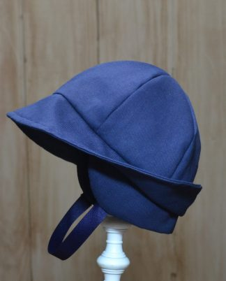 Handmade navy twill earlap hat.