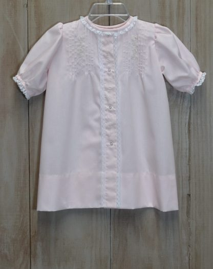 Rose daygown in Pink Blush Imperial Batiste with pink and green embroidery and white lace. It has fine hand sewn tucks at the top and buttons down the front. This daygown measures 17 inches in length and typically fits from birth to 7 months.