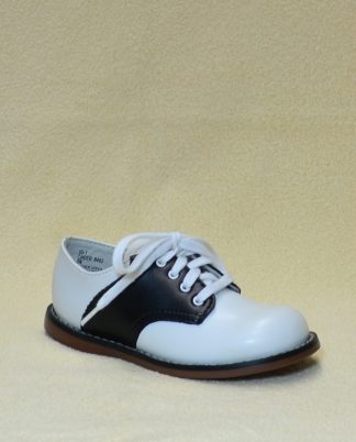 """White and black oxford by """"Footmates""""."""