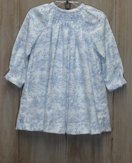 """Blue and white toile print long sleeve dress with a small section of smocking in the top center by """"Anavini"""""""
