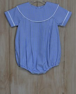 """Royal gingham romper with large round collar trimmed in white piping by """"Delaney""""."""