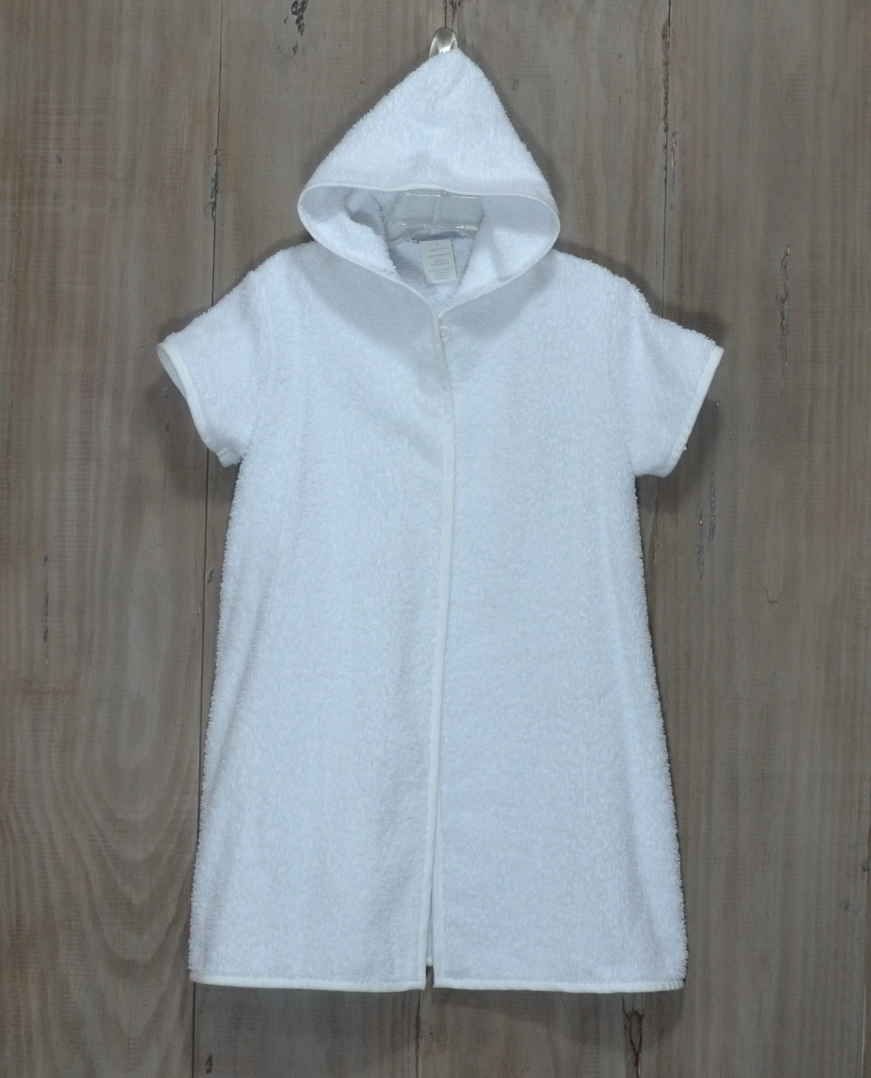 33869c702b White terry cloth swimsuit cover-up that can be for a boy or a girl