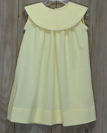 Martha sundress in yellow seersucker trimmed in white piping. Perfect for monogramming! Handmade by local seamstresses.