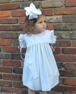 Handmade Cailyn dress in a white and lavender floral print with a white batiste collar.