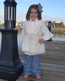 Ivory vintage furry vest with a flower closure.