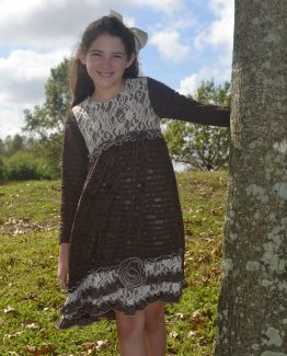 Brown knit fabric dress with ivory lace bodice and long sleeves.