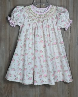 "Beautiful ivory and pink vintage rose print bishop dress with pink gingham trim. Spring is in bloom and so is this dress! By ""Petit Ami""."