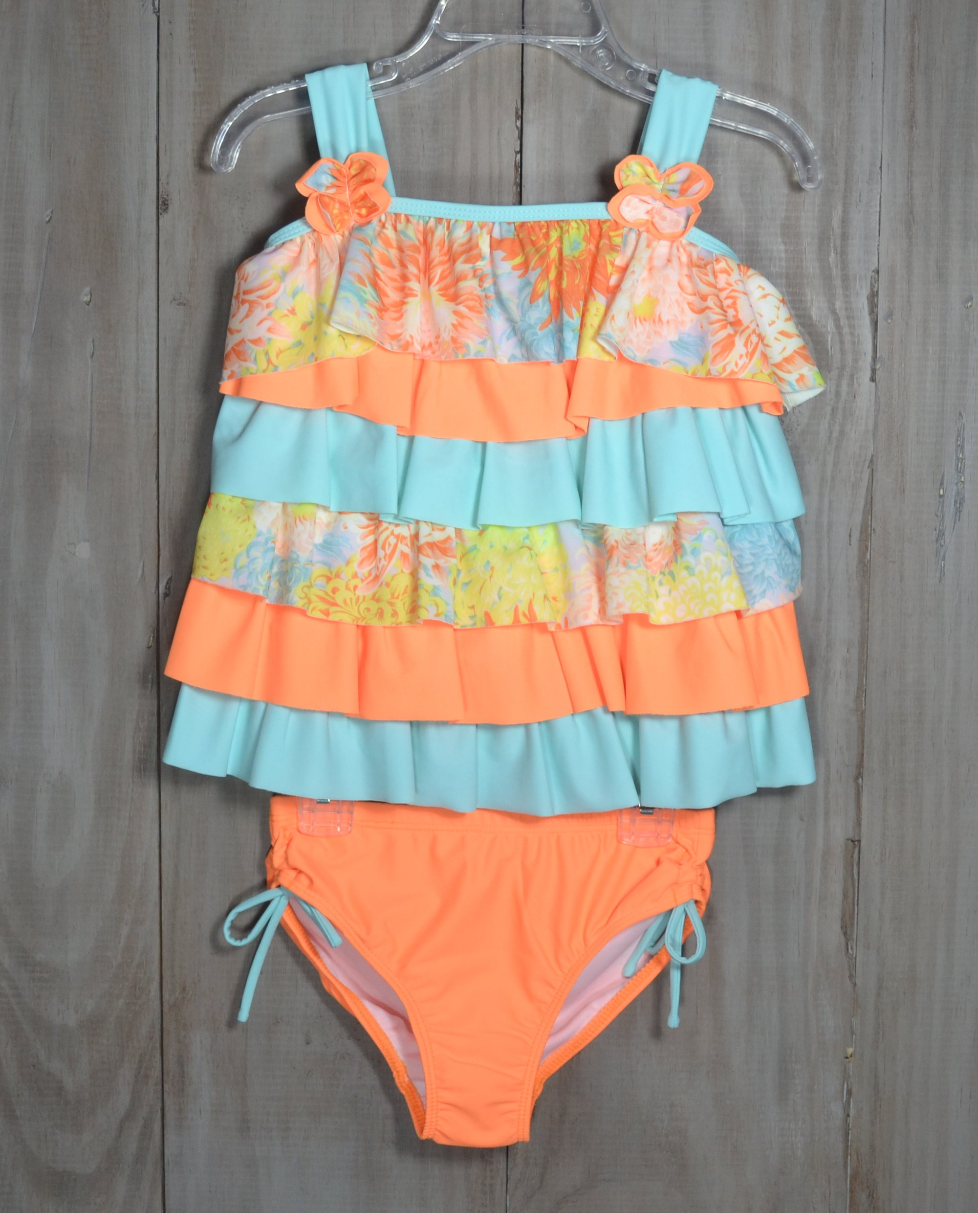 2ac075d8ac Fun 2 piece swimsuit in orange and mint solids and floral print. The top  has · Isobella & Chloe