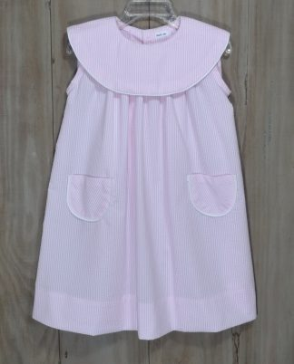 Martha dress in light pink seersucker. The round collar and pockets are trimmed in white piping. This collar is perfect for monogramming!