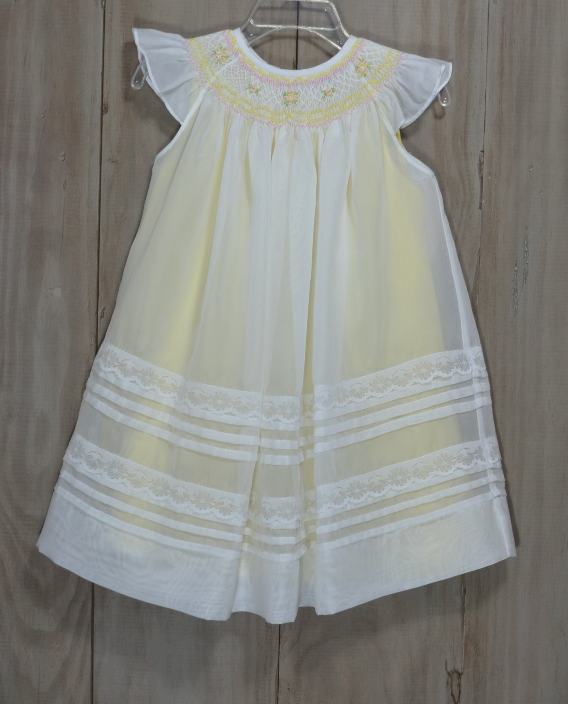 e63bb08ab925 Beautiful white organza sundress smocked in yellow and pink with a yellow  slip underneath. The