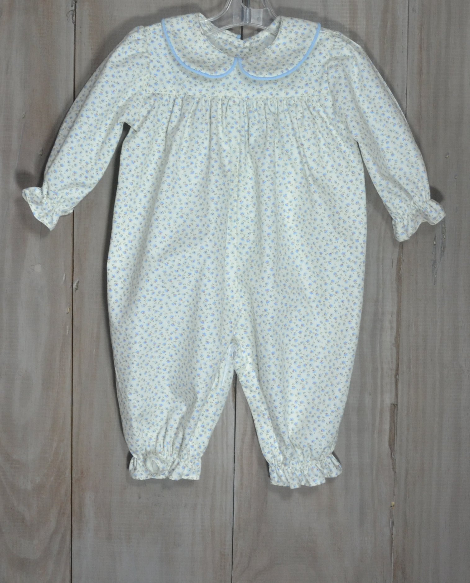 This sweet bubble is in an ivory and blue floral vintage print and is  trimmed in
