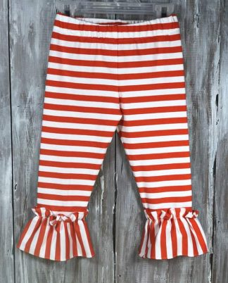 """Orange and white striped knit pant with ruffles at the bottom by """"Vive La Fete"""". Pair it with a festive t-shirt for Fall."""