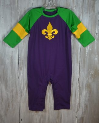 """Purple knit longall with green and gold accents and a fleur de lis applique' by """"Koko-nut Milk"""". So comfortable and festive for the Mardi Gras season and can be worn by boys or girls!"""