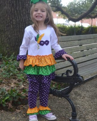 Mardi Gras knit pants set with a mask appliqued on the shirt accented with colorful ruffles!