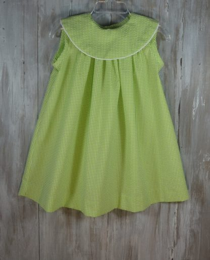 """""""Martha"""" sundress in lime green seersucker with a round collar trimmed in white piping. One of the most popular of our handmade dresses and is ideal for monogramming!"""