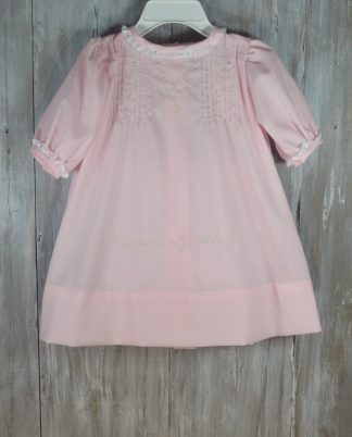 """Heirloom Ava daygown in Pink Blush Batiste has fine hand sewn tucks and white, pale pink, and green embroidery with white lace. This daygown usually fits up to 7 months and measures 16 1/2"""" in length."""