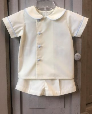 """Sweet traditional shorts set in pale yellow batiste with pale blue accents by """"Remember Nguyen""""."""