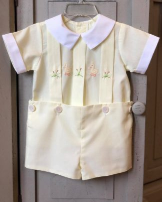 """Baby yellow batiste shirt with box pleats and sweet ducks embroidered across the front with matching shorts attached with buttons by """"Remember Nguyen""""."""