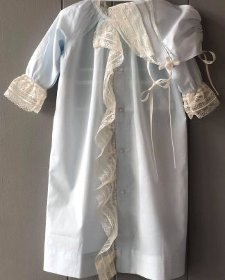 """This beautiful daygown is in a pale blue 100% cotton batiste and trimmed with ivory insertion and laces. It is paired with a matching cap and the set is by """"Sen Baby"""". Perfect for a take-me-home outfit or for your baby's first portraits!"""