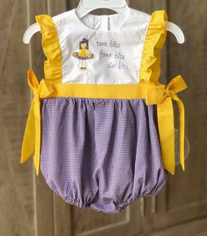 """""""Two Bits, Four Bits, Six Bits"""" festive bubble in purple gingham and white with gold ruffled accents and ties. Root for your favorite purple and gold team especially our LSU Tigers! See the matching older sister look, both are by """"Krewe""""."""