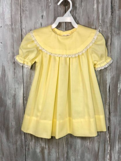 """Handmade """"Patsy"""" dress in lemon yellow batiste trimmed in white crocheted lace. Perfect for monogramming!"""