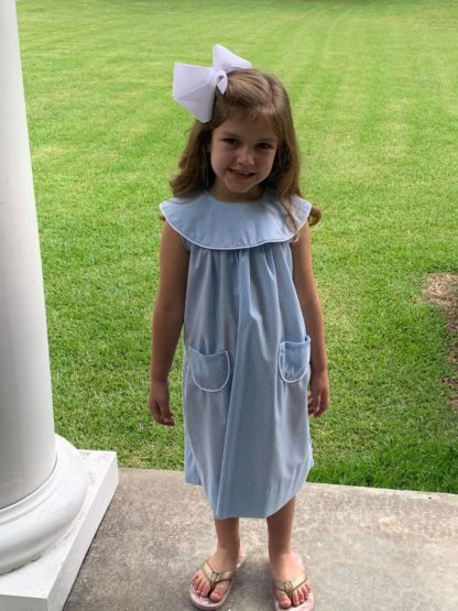 """Martha dress in light blue 1/16"""" gingham. The round collar and pockets are trimmed in white piping. This collar is perfect for monogramming!"""