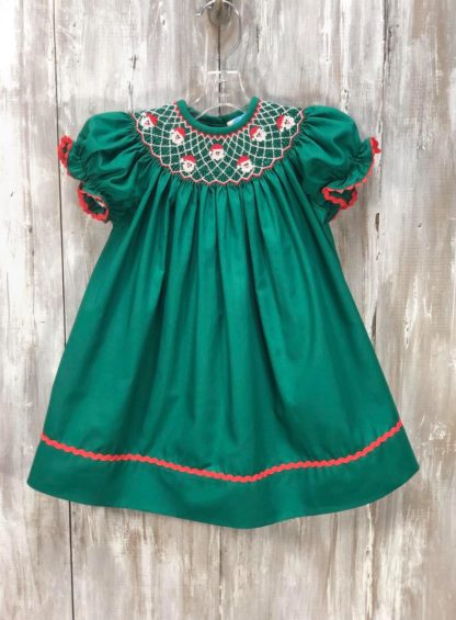 """Dark green bishop dress smocked in red and white with Santa faces by """"Krewe""""."""