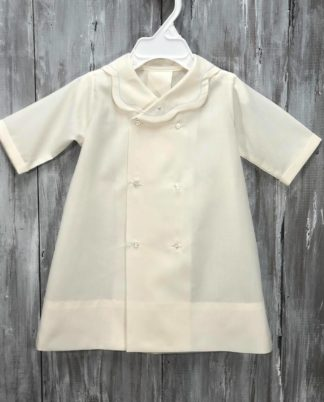 """Our sweet apron daygown in Ecru Batiste with light blue feather stitching on the collar. The length is 17"""" and typically fits up to 7 months."""
