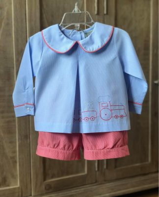 """Light blue gingham top trimmed in red gingham with matching shorts. The top has a sweet train outline with a teddy bear passenger. Set is by """"Honesty""""."""