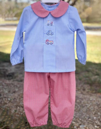 """Blue and red gingham pant set with embroidered pictures of first responders on the shirt. There's an ambulance, a police car, and a fire truck. Set is by """"Baby Sen by Remember Nguyen""""."""