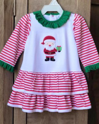 """Soft knit dress in red stripes accented in kelly green with an applique' of a jolly Santa by """"Tigel's""""."""