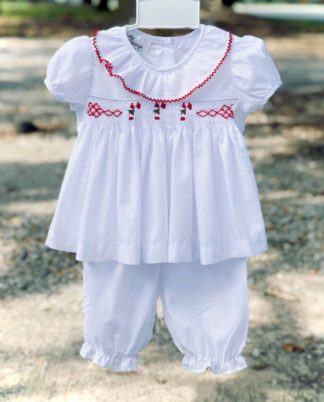 """White batiste bloomer pant set with a sweet top smocked with candy canes by """"Baby Blessings""""."""