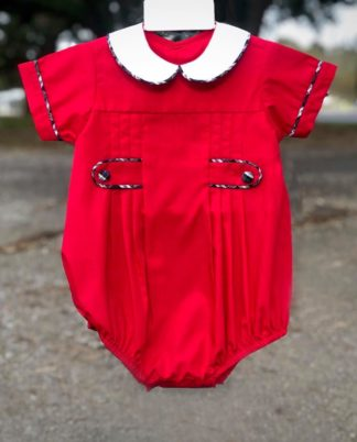 """Red bubble with pleats and a peter pan collar with accents of a navy and green plaid trim by """"Remember Nguyen""""."""