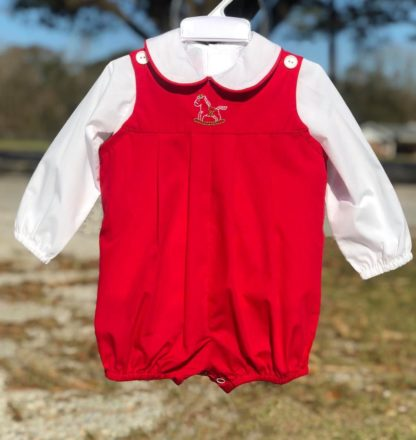 """Red broadcloth bubble with a stitched rocking horse paired with a white shirt piped in red by """"Baby Sen by Remember Nguyen""""."""
