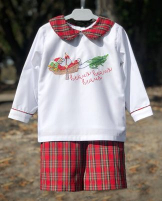 """Red tartans plaid shorts paired with a white cotton shirt with a Cajun Santa yelling """"Heaux Heaux Heaux"""" being pulled by alligators. Set by """"Little Louanne""""."""