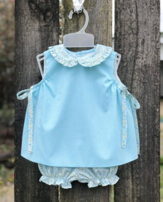 """This sweet set is one of our favorites this season! The light aqua gingham top is accented with a floral collar and paired with matching floral bloomers. The set is by """"Baby Sen by Remember Nguyen""""."""