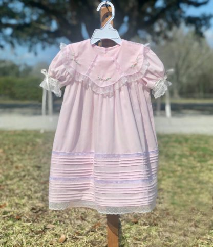 """Light pink batiste dress with tucks, insertion, lace, and embroidery that give it a beautiful vintage heirloom look that's perfect for portraits, weddings, or any special occasion. By """"Phoenix & Ren""""."""