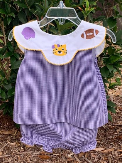 Purple and white gingham bloomer set trimmed in gold tatting with an embroidered tiger, helmet and football. The back collar falls into a V pattern and is accented with a bow. Perfect for LSU football games and tailgating! Geaux Tigers! See matching boy and girl looks!