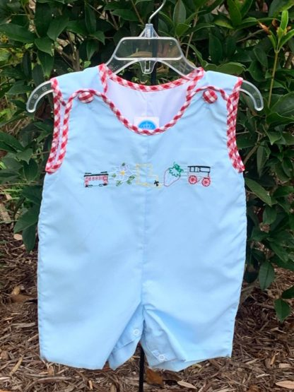"""Light blue Jon Jon accented with red gingham trim with stitched pictures representing the great state of Louisiana! The pictures are of a NOLA street car, the magnolia state flower, the state of LA, a strawberry, and a carriage. See the matching girl's bloomer set! By """"Krewe""""."""