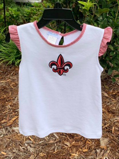 """White knit top with a red and black ULL fleur de lis applique'. This top matches our red check fleur de lis shorts and both are perfect for tailgating and watching Ragin Cajuns sports! By """"Vive La Fete""""."""