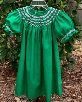 """Kelly green bishop dress with white smocking and white pearls by """"Mom & Me""""."""