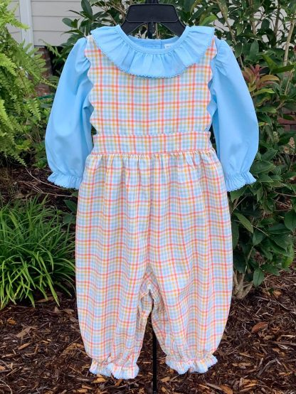 """Plaid jumper longall in the colors of blue, orange, and gold paired with a blue blouse. The scalloped accents make this set unique and and the back is just as sweet as the front. By """"Sage & Lilly""""."""