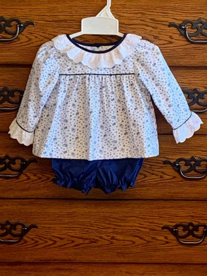 """Sweet navy blue floral top trimmed in eyelet paired with a navy bloomer by """"Baby Blessings""""."""